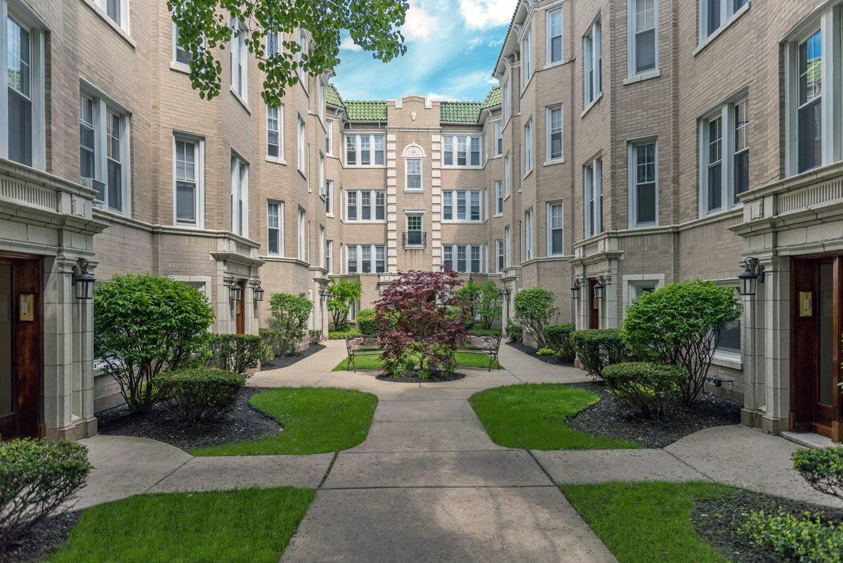 One BR Apartment - With its green tiled roof and landscaped courtyard. Apartments photo #1
