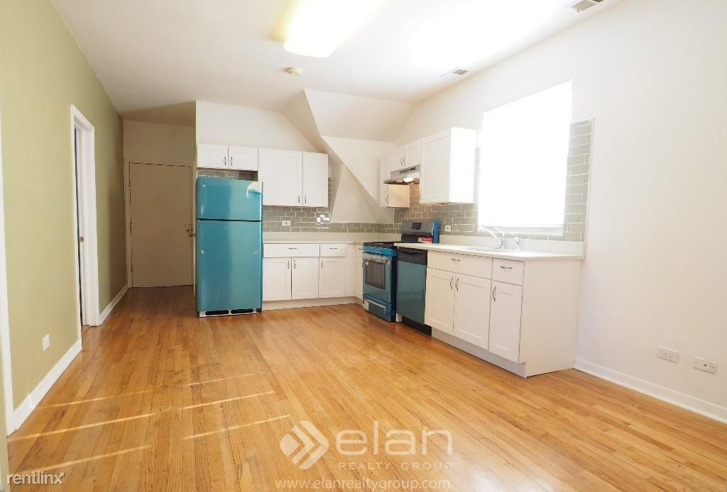 3919 N RAVENSWOOD Apt 3 photo #1