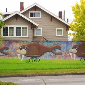 Photo of Mural of Three Walruses Riding Tiny Bicycles