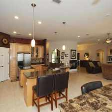 Rental info for Custom Home with screened in pool/hot tub! Call Today!
