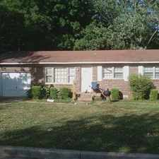 Rental info for Section 8 inspected and approved! All brick rancher, garage, fenced back yard, new paint.