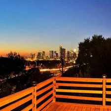 Rental info for Custom built home on hillside lot with amazing view of downtown.