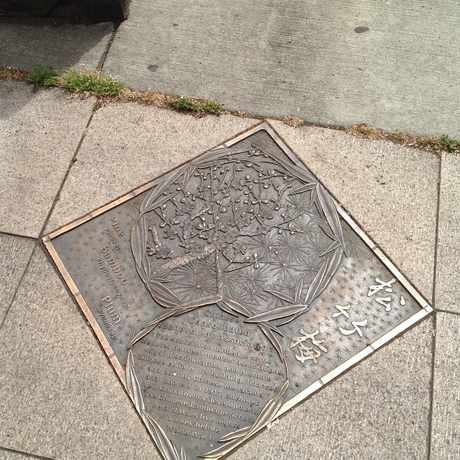 Photo of Historical markers decorate China Town in Old Town Chinatown, Portland